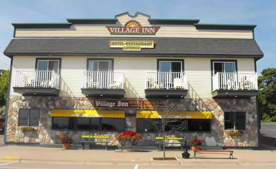 Street view of the Village Inn of St. Ignace