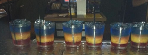 Red, yellow and blue drinks at the bar in the Village Inn of St. Ignace